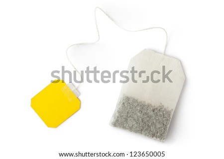 Teabag with yellow label. Top view. Isolated on a white. - stock photo