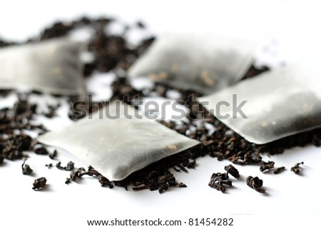 Teabags and tea on white background