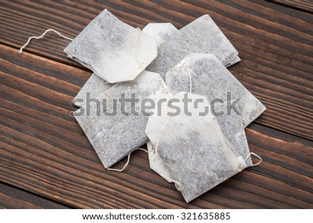 teabags on a wooden background - stock photo