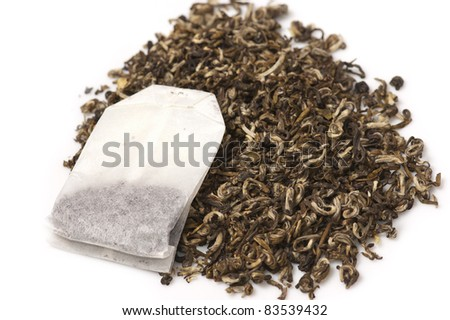 Teabags with the green tea as the background/Tea and teabag - stock photo