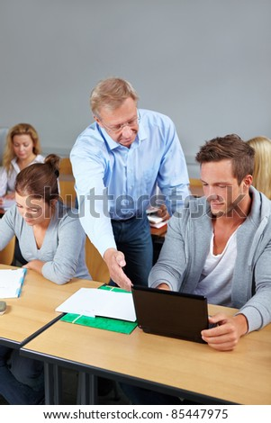 Teacher and college student in a class - stock photo