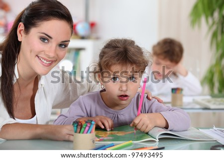 Teacher and her students - stock photo