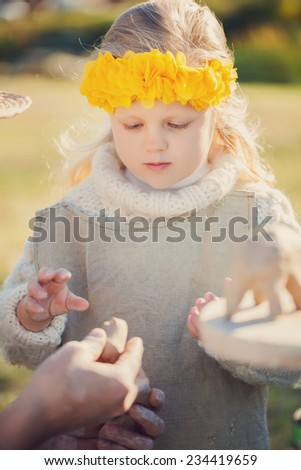 Teacher and kid potters at workshop - stock photo