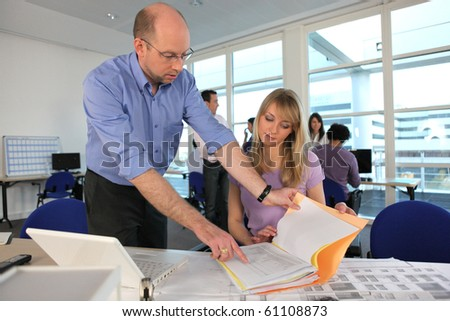 Teacher and student in architecture - stock photo