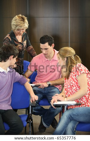 Teacher and students - stock photo