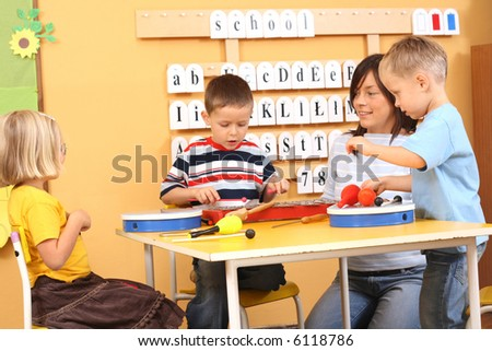 teacher and three preschoolers playing with instruments