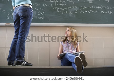 Teacher Assisting Student - stock photo