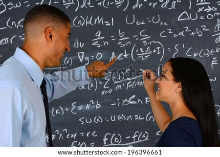 Teacher at school in the classroom ready for work - stock photo