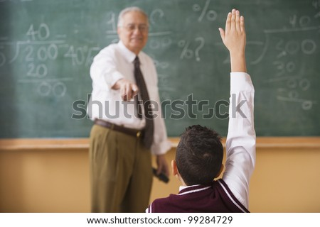 Teacher calling on student to answer a question - stock photo