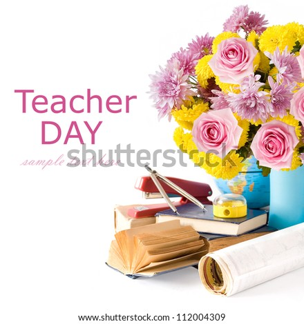 Teacher Day (still life with autumn flowers and roses, book, map and sharpener isolated on white with sample text) - stock photo
