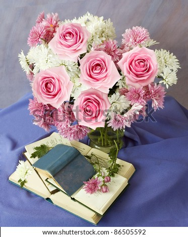 Teacher day (still life with books and bunch of pink roses and asters) - stock photo
