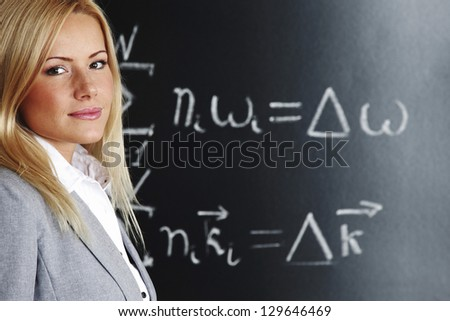 teacher draw condition of phase synchronism - stock photo