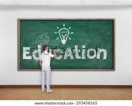 teacher drawing education concept on green blackboard - stock photo