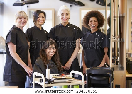 Teacher Helping Mature Students In Hairdressing - stock photo