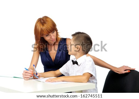 teacher helps the student - stock photo