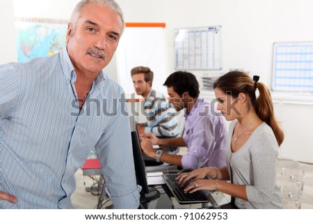 Teacher in management training - stock photo