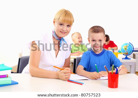 teacher makes the lessons with their children in school.