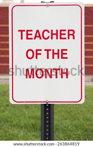 Teacher of the month parking sign.  School often reserve parking spaces to recognize their best teachers. - stock photo
