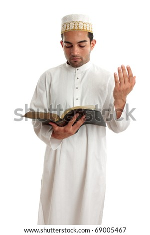 Teacher or preacher reading from a religious book, or other literary book.  White background. - stock photo