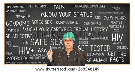 Teacher pointing to Safe Sex Blackboard: Get Tested, Know Your Status, Get Facts, Protection, Question, Responsible Sex, Truth, Be Aware, Unsure Say No, Sober Sex - stock photo
