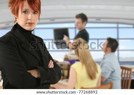 Teacher / Professor and students in college class room. - stock photo