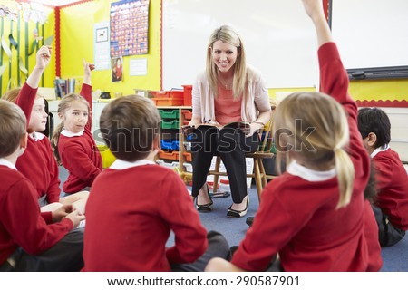 Teacher Reading Story To Elementary School Pupils - stock photo