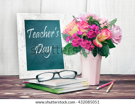 Teacher's day holiday greeting icon. Education knowledge day concept. Wooden chalk board frame and vase bouquet on table empty copy space.