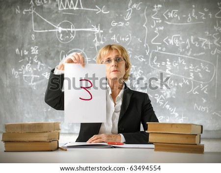 Teacher showing a bad note - stock photo