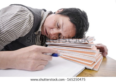 teacher / student sleeping on a pile of books  - stock photo