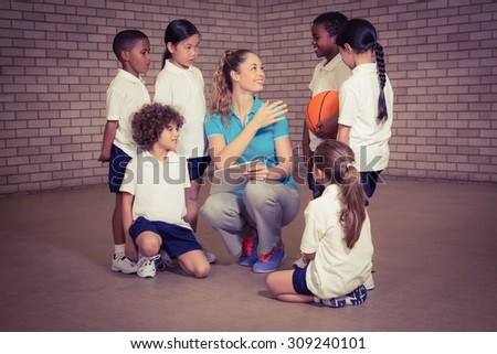 Teacher talking with sports students at the elementary school - stock photo