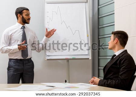 Teacher teaches the student.Business training.  - stock photo