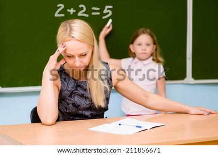 teacher tired of stupid student - stock photo