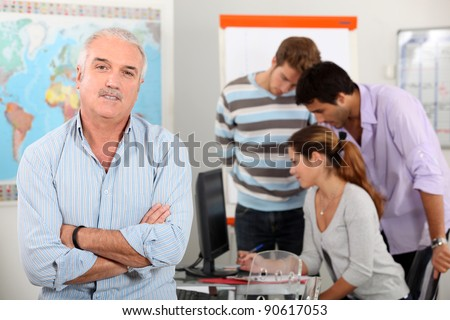 Teacher with a group of mature students - stock photo