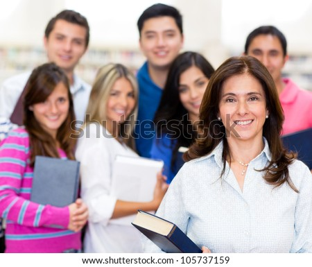 Teacher with a group of students at the university - stock photo