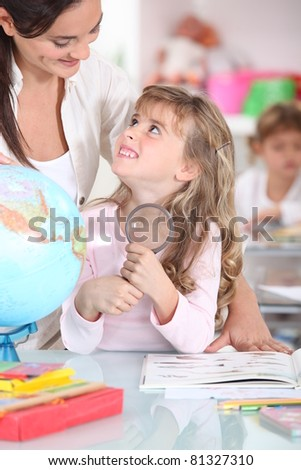 Teacher with a pupil - stock photo