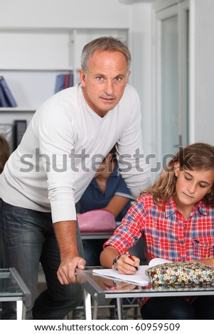 Teacher with students in classroom - stock photo