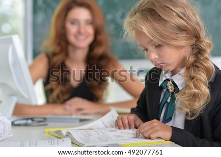 teacher with two girl at lesson