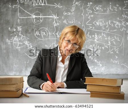 Teacher writing - stock photo
