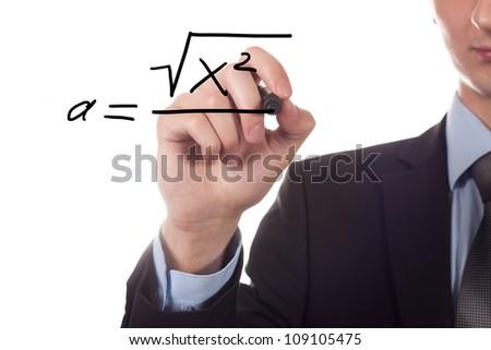 Teacher writing a mathematical equation. - stock photo