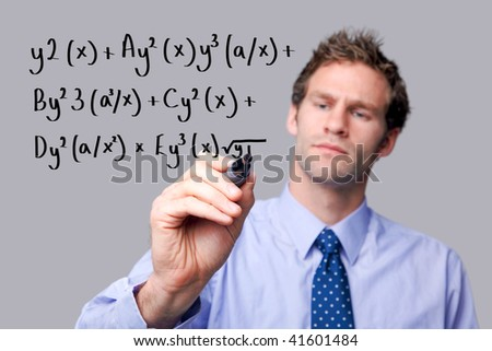 Teacher writing a mathematical equation on a glass screen. The background is a uniform color all over so you can increase the copy space easily. Focus is on his hand and pen. - stock photo