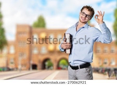 Teacher. Young funny man in glasses against chalk blackboard - stock photo