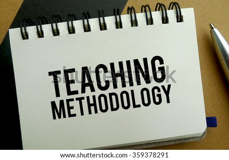 Teaching methodology memo written on a notebook with pen