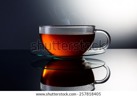 teacup with hot tea and steam - stock photo