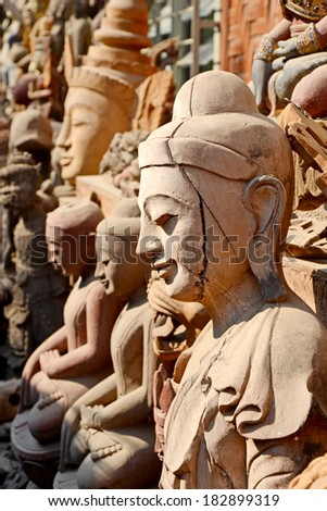 Teak Wood Craved Buddha Statue in Burmese Style. Very Best Craved Teak Wood Art in Myanmar Made in Mandalay, The Old City of Religion and Culture. - stock photo
