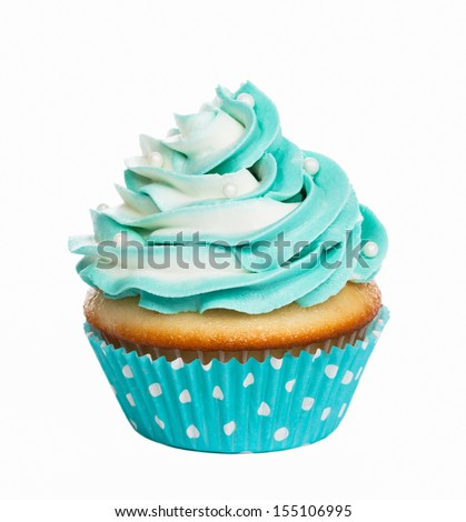 Teal birthday cupcake with butter cream icing isolated on white. - stock photo