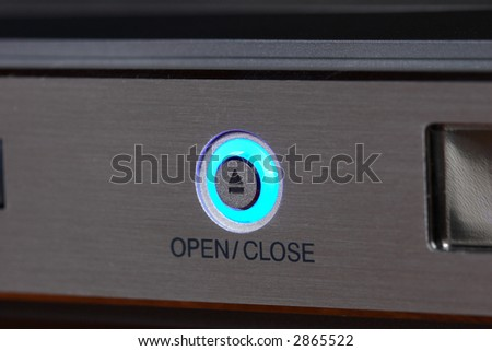 Teal light button for open/close disk - stock photo