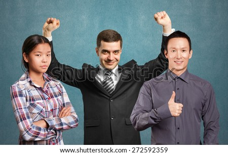 Team and happy businessman with hands up, celebrating his victory - stock photo