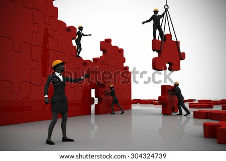 Team building a jigsaw puzzle. A team building a giant jigsaw puzzle while directed by a successful leader. - stock photo