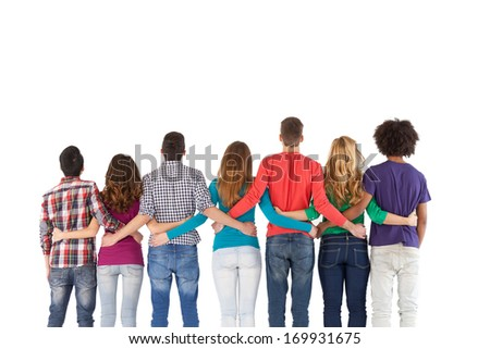 Team building. Rear view of multi-ethnic people standing close to each other while isolated on white - stock photo