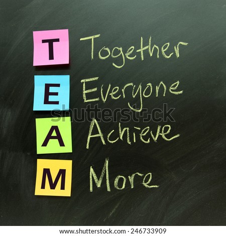 Team concept on black board indicates together everyone achieve more - stock photo